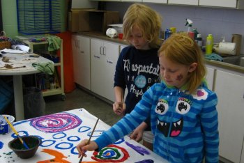 Two students painting in the art room.